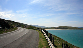 A road winding along the coast on a bright sunny day